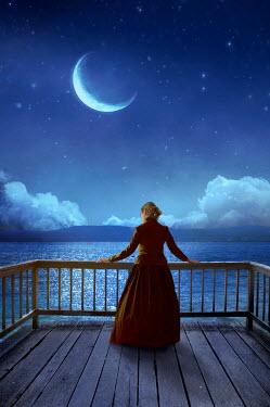 Drunaa Woman watching  sea and the moon