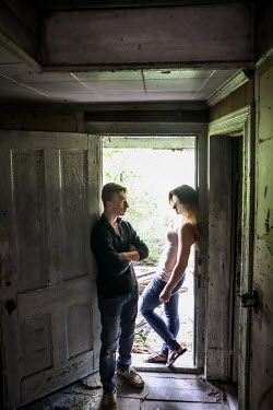 Stephen Carroll COUPLE STANDING IN DOORWAY OF DERELICT HOUSE Couples