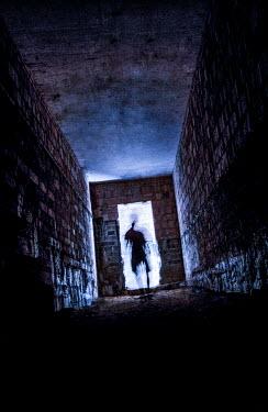 Jaroslaw Blaminsky SILHOUETTE IN SINISTER BRICK BUILDING Men