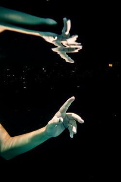 Stephen Carroll REFLECTED FEMALE HAND FLOATING IN WATER Women