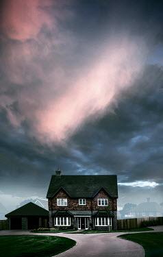 Trevor Payne House on suburban road and cloudy sky Houses