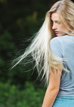 Elisabeth Ansley Young girl with flowing blonde hair outside Women