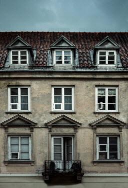 Jaroslaw Blaminsky House with balcony against grey sky Houses