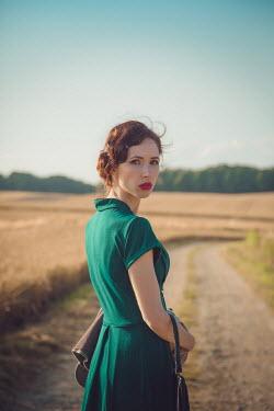 Joanna Czogala Retro woman stood in country lane Women