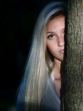 Elisabeth Ansley Young blonde girl hidden behind tree Women