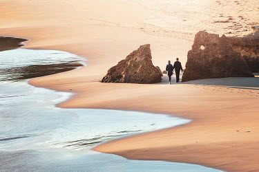 Evelina Kremsdorf Couple walking on sandy beach Couples