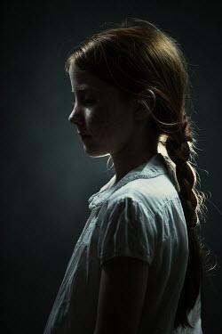 Magdalena Russocka little girl in dark room Children