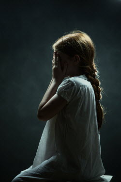 Magdalena Russocka little girl in dark room with face covered with hands Children