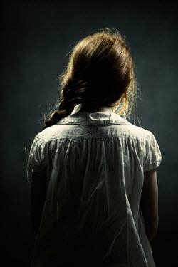 Magdalena Russocka sad little girl sitting in dark room Children