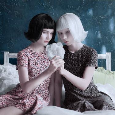 Ranat Renee TWO GIRLS HOLDING FLOWER ON BED Women