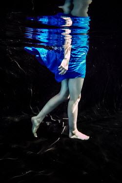 Stephen Carroll WOMAN WALKING BAREFOOT IN WATER Women