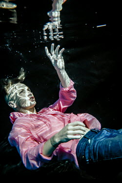 Stephen Carroll CLOSE UP OF MAN SINKING UNDERWATER Men