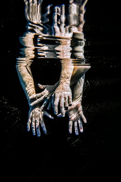 Stephen Carroll REFLECTIONS OF HANDS UNDERWATER Body Detail
