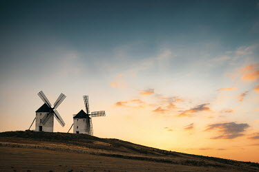 Evelina Kremsdorf TWO WINDMILLS ON HILL AT SUNSET Miscellaneous Buildings