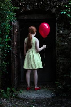 Magdalena Russocka little girl with red balloon entering basement