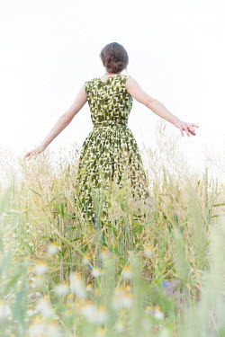 Helen Mayer CAREFREE WOMAN IN PATTERNED DRESS IN FIELD Women