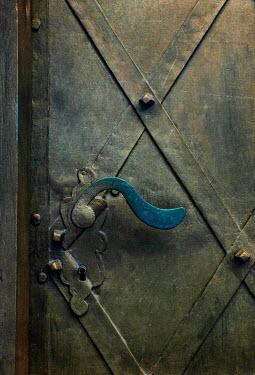 Jaroslaw Blaminsky CURVED HANDLE ON IRON DOOR Building Detail