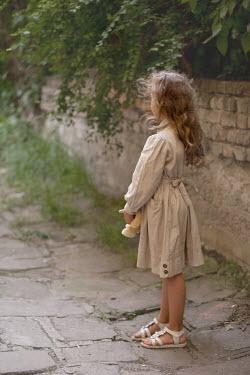 Kerstin Marinov Little girl stood on rural lane Children