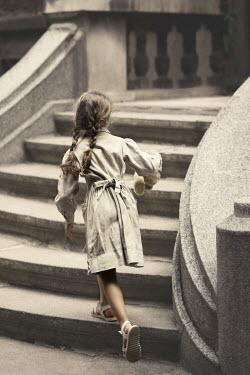 Kerstin Marinov Little girl climbing stairs Children