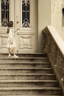 Kerstin Marinov Little girl knocking on door Children