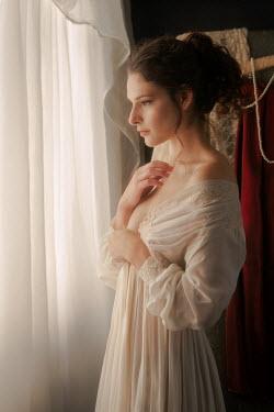 Michael Nelson Woman looking out of window Women