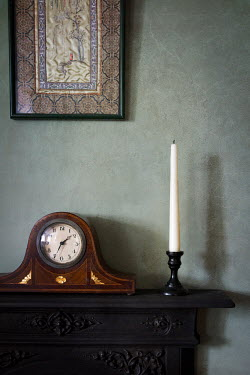 Peter Chadwick ANTIQUE CLOCK ON MANTLEPIECE WITH CANDLE Interiors/Rooms