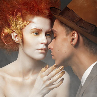 Ranat Renee WOMAN WITH RED HAIR TOUCHING MAN WITH HAT Couples