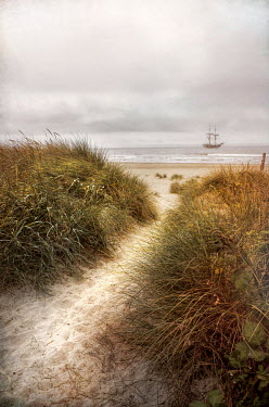 Jill Battaglia path in sand dunes with historical ship Boats