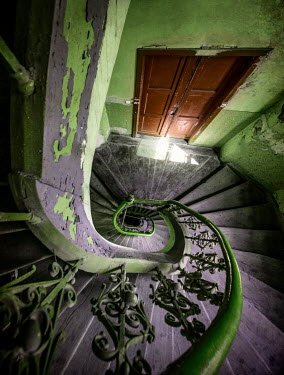 Jaroslaw Blaminsky Old purple and green spiralling staircase Interiors/Rooms