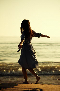 Mohamad Itani Woman dancing by sea Women