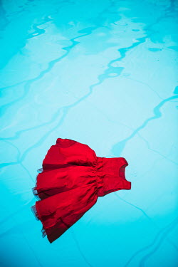 Magdalena Russocka child's red dress floating on swimming pool Miscellaneous Objects