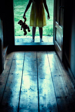 Magdalena Russocka little girl with teddy bear entering old wooden house Children