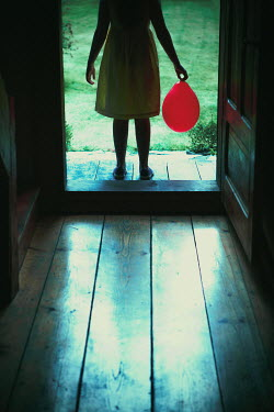 Magdalena Russocka little girl with red balloon standing on doorstep Children