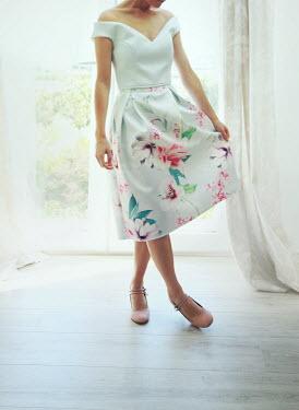 Mark Owen Woman by door in floral dress Women