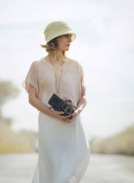 Mark Owen Woman with retro camera in road Women