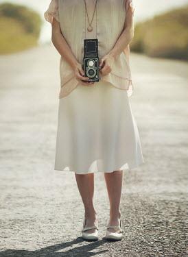 Mark Owen Woman holding retro camera Women