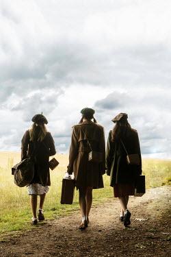 Stephen Mulcahey three evacuee girls walking in field Groups/Crowds