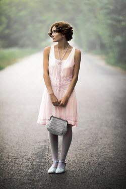 Ildiko Neer Retro woman standing on country road Women