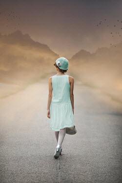 Ildiko Neer Retro woman walking on country road Women