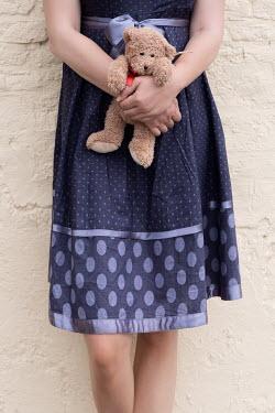Maria Petkova young woman holding teddy bear Children