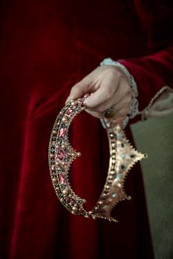 Jaroslaw Blaminsky Historic woman holding golden crown Women