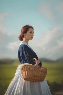 Joanna Czogala Historical woman and basket outdoors Women
