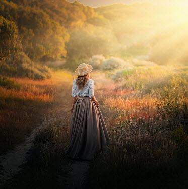 Lilia Alvarado Woman stood in sunlit field Women