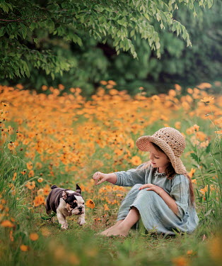 Lilia Alvarado Girl playing with flower and dog Children