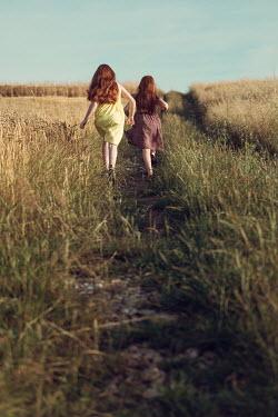Magdalena Russocka two little girls running in field Children