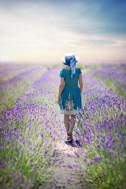 Evelina Kremsdorf Woman walking in lavender field Women