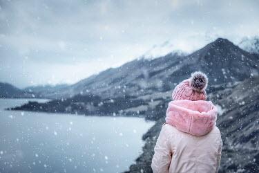 Evelina Kremsdorf girl watching lake with snowy mountains Women