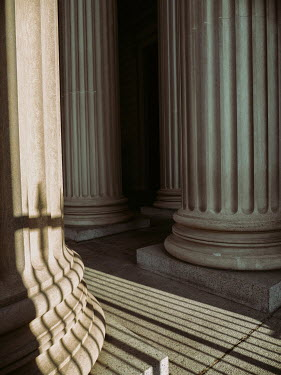 Elisabeth Ansley LARGE STONE COLUMNS WITH SUNLIT PATTERNS Building Detail