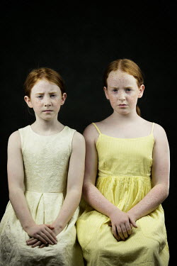 Magdalena Russocka two little girls sitting side by side