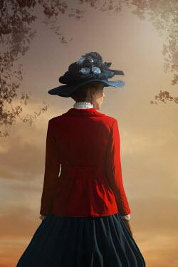 Ildiko Neer Historical woman standing at sunset